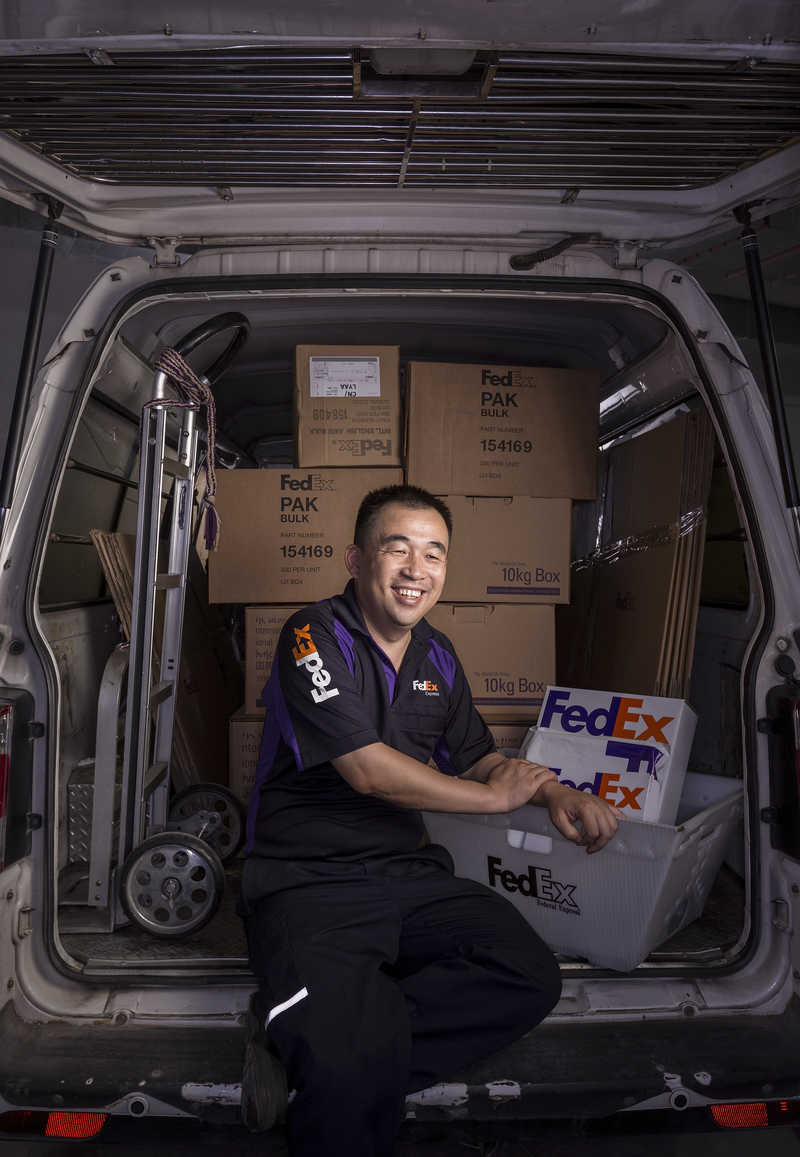 Qing Hua, a FedEX worker in Shenzhen, China.