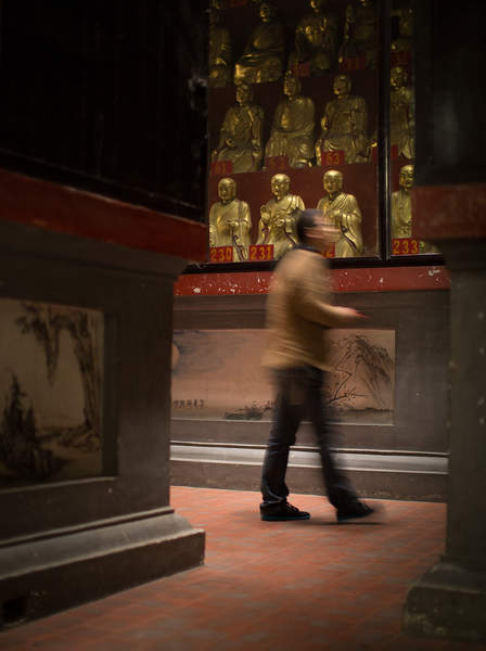 A man walks through a building at the Kaifu Temple