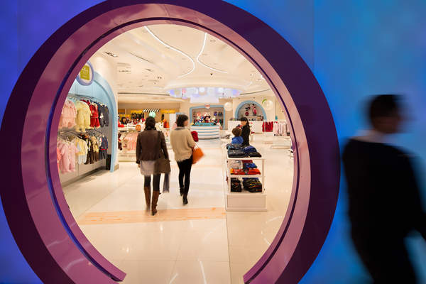 People walk through the Kid's Cavern department store inside the Sands Cotai Central resort shopping mall