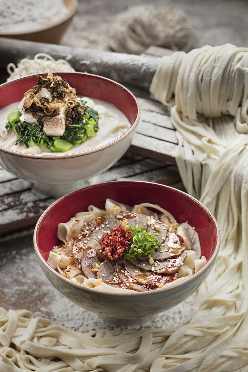 Stylized northern Chinese noodle and noodle making photograph.