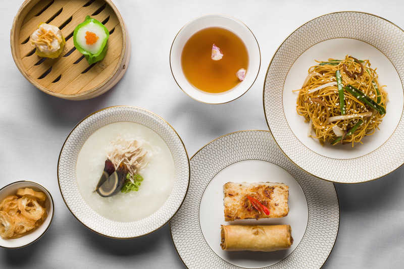 Dim sum set, including congee and fried noodles.