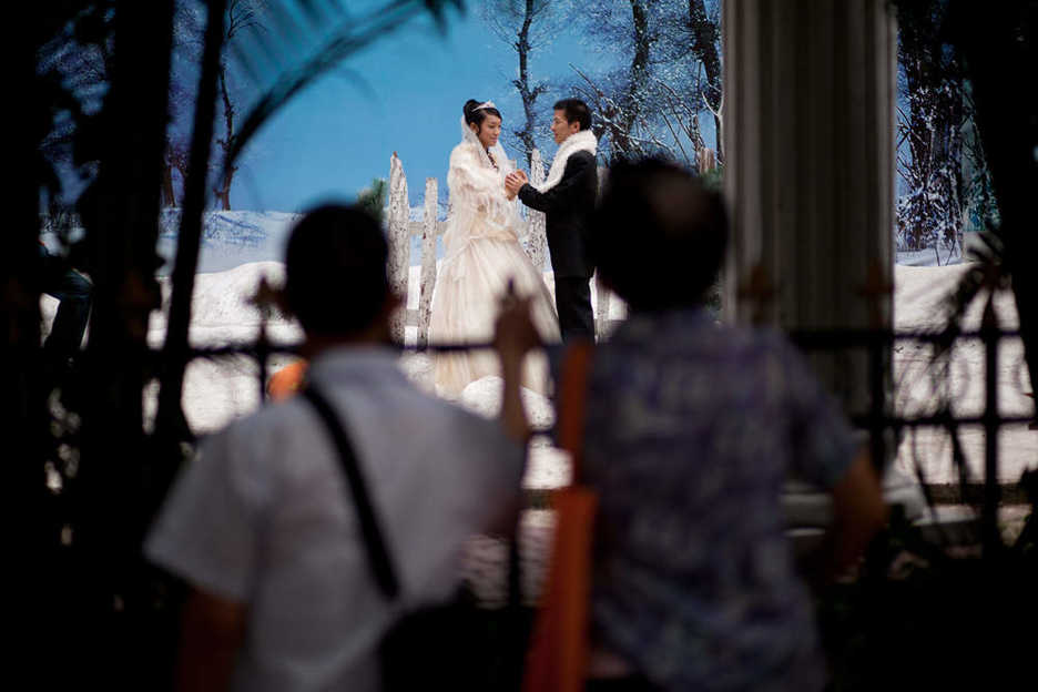 A couple is photographed at The Wedding of the Century in Guangzhou, China
