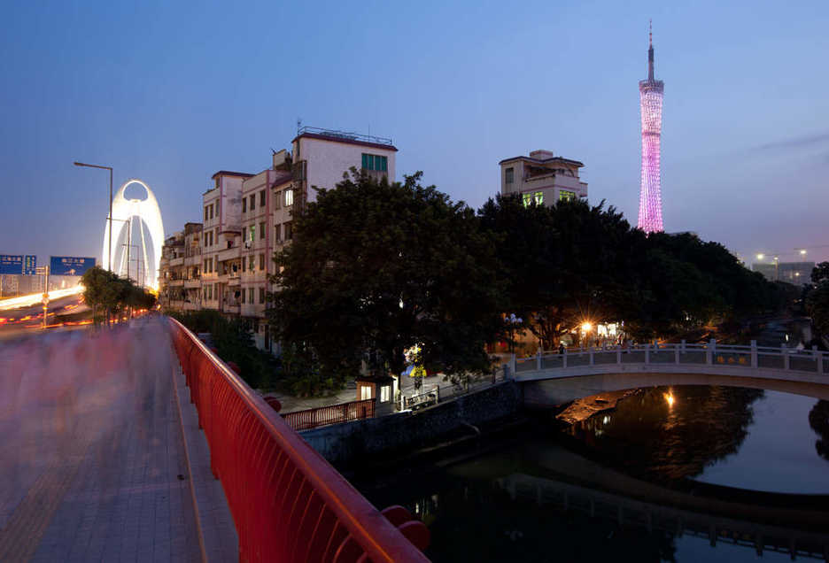 Guangzhou TV tower and Bridge seen over a small water village in Tianhe district