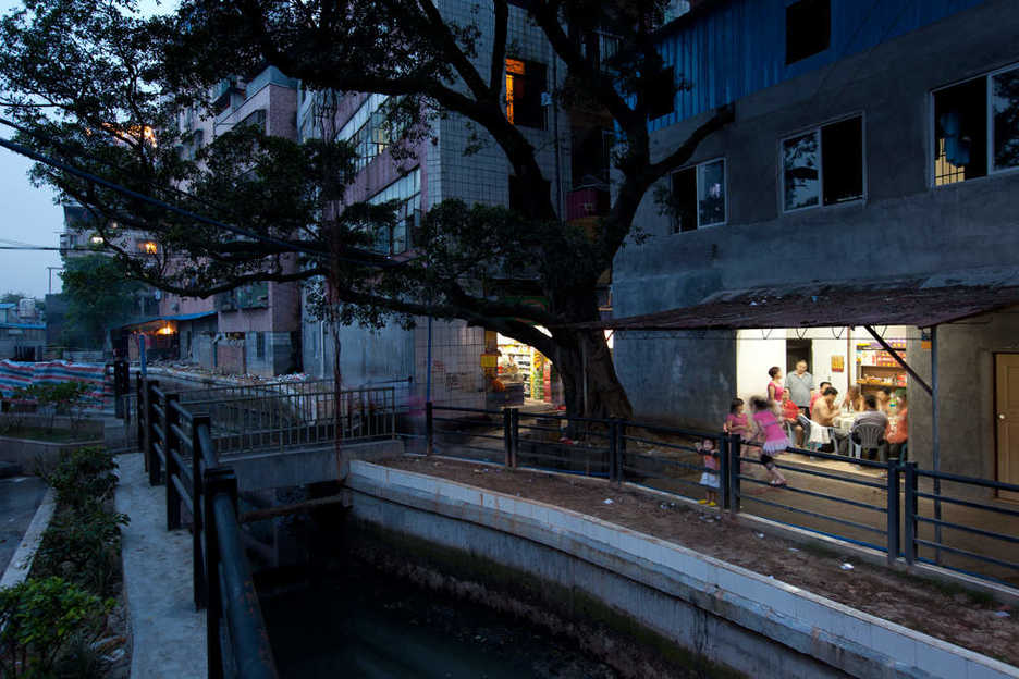 An eatery is aglow in an older community in east Tianhe district, Guangzhou.