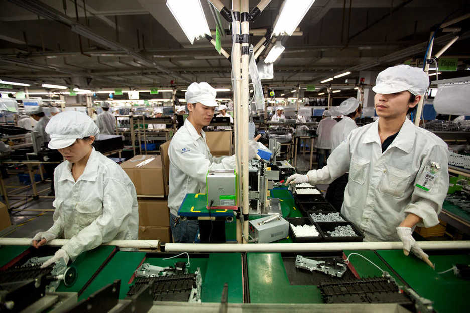 Workers assemble computer printers at Hon Hai's Shenzhen campus