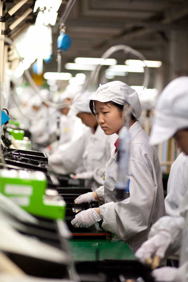 Workers assemble electronics at Hon Hai's Shenzhen campus