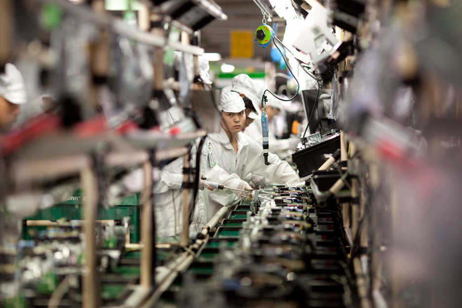 Foxconn Workers assemble computer printers in Shenzhen China.