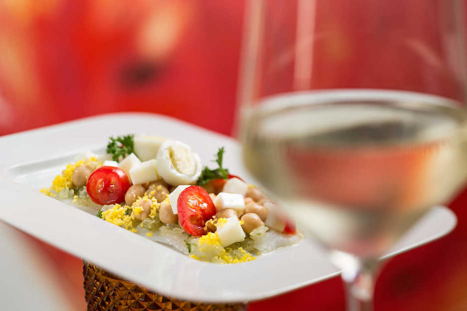 A tomato and cheese dish with wine at Fado restaurant in Macau