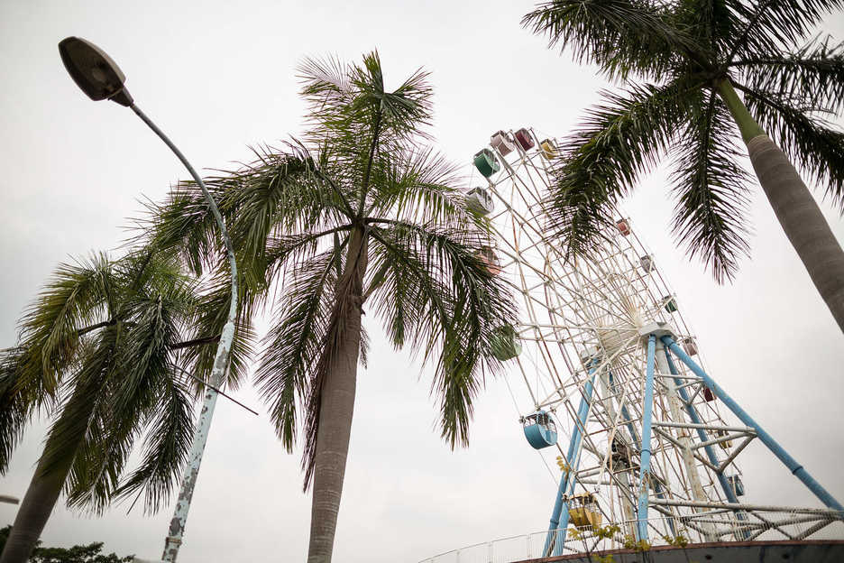 An disused Ferris wheel sits at the Honey Lake amusement park in Shenzhen, China