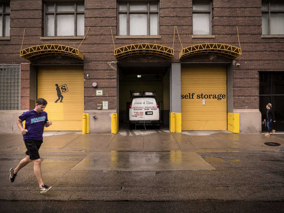 People walk past a storage facility in Chicago