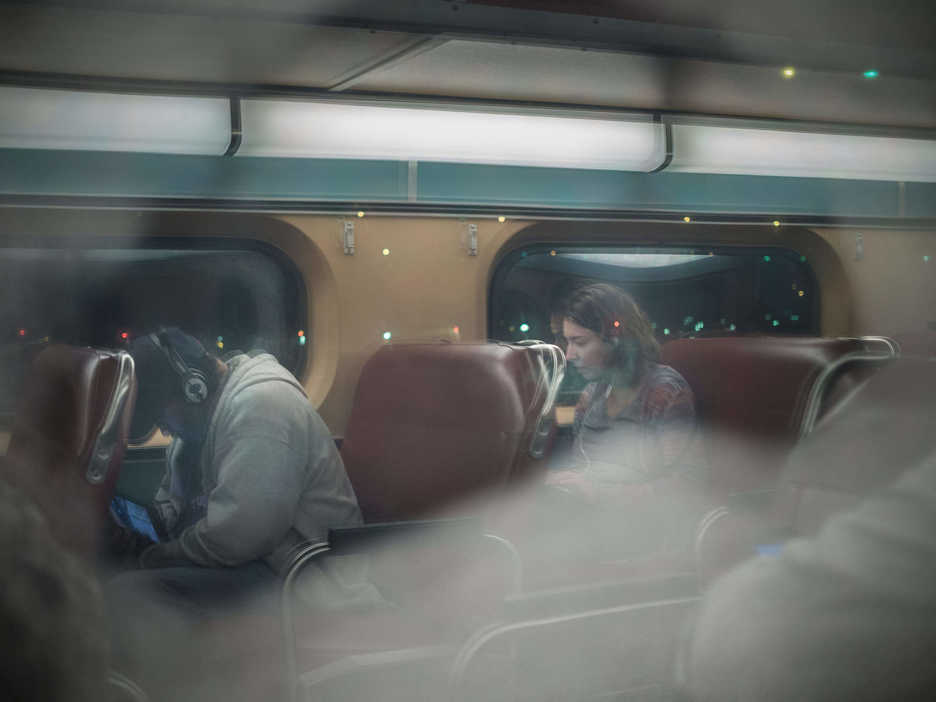People sit in a commuter train car en route to Downers Grove Illinois