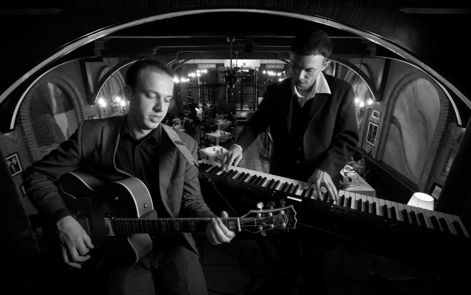 Jazz guitarist Thomas Hoogland and pianist Christopher Stiles pose at Vino Restaurant and Bar in Tianhe District, Guangzhou