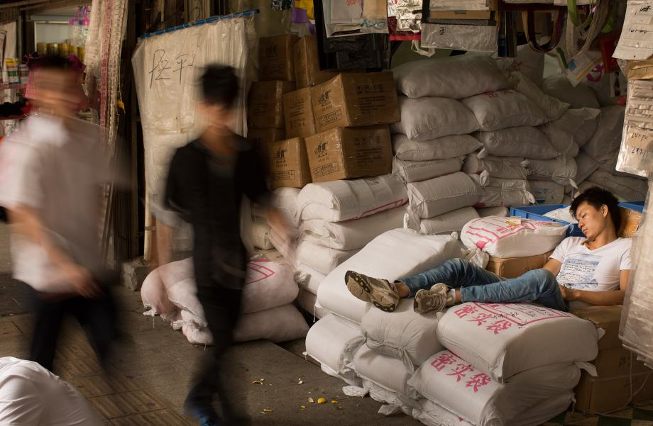A worker naps at the Yide Lu wholesale market in Haizhu District