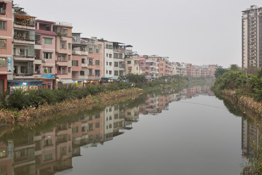Houjiaocun, an urban village, is seen at dusk in Haizhu District