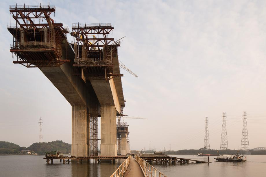 A bridge is under construction on the Pearl River in near Huangpu Village