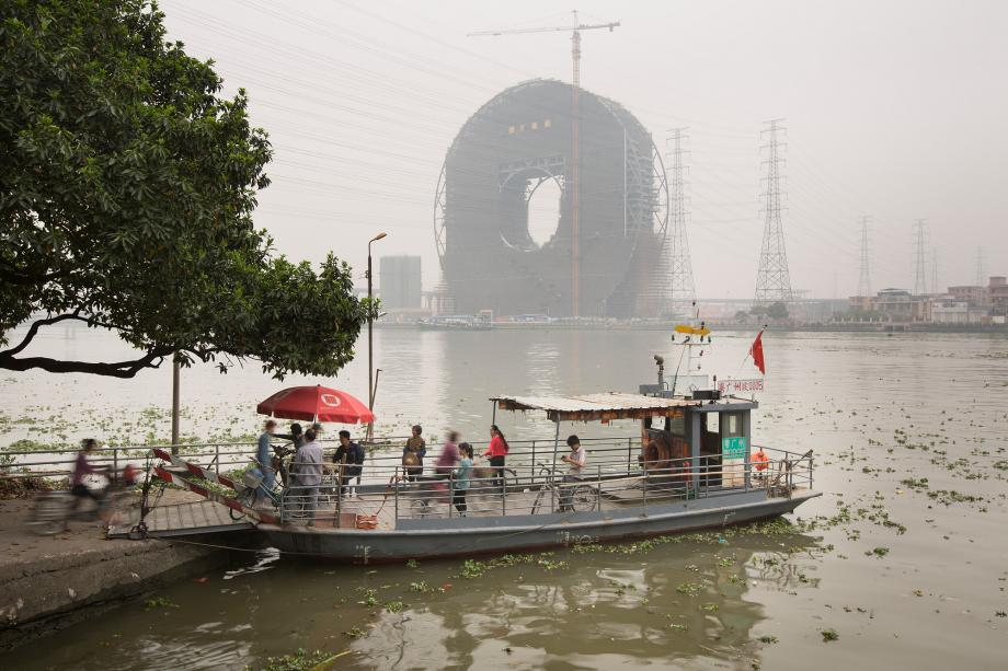 People board a ferry on the Pearl River in Panyu, Guangzhou