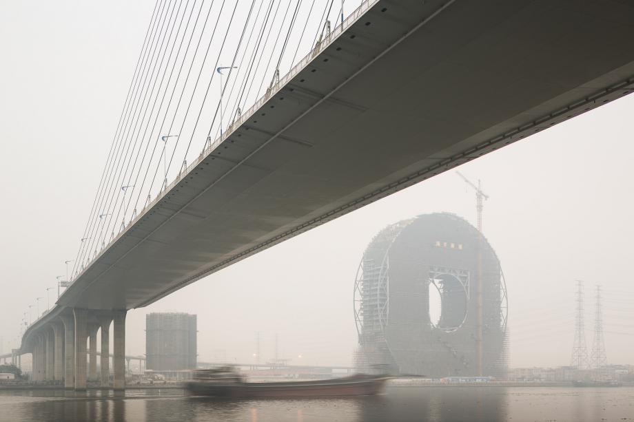 A cargo ship passes along the Pearl River in Guangzhou